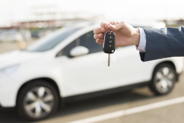 businessman-with-keys-front-car_23-2147986531