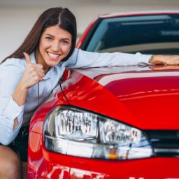 young-woman-buying-car_1303-13628